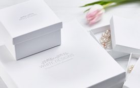 White Designs white boxes with logo. Packaging.