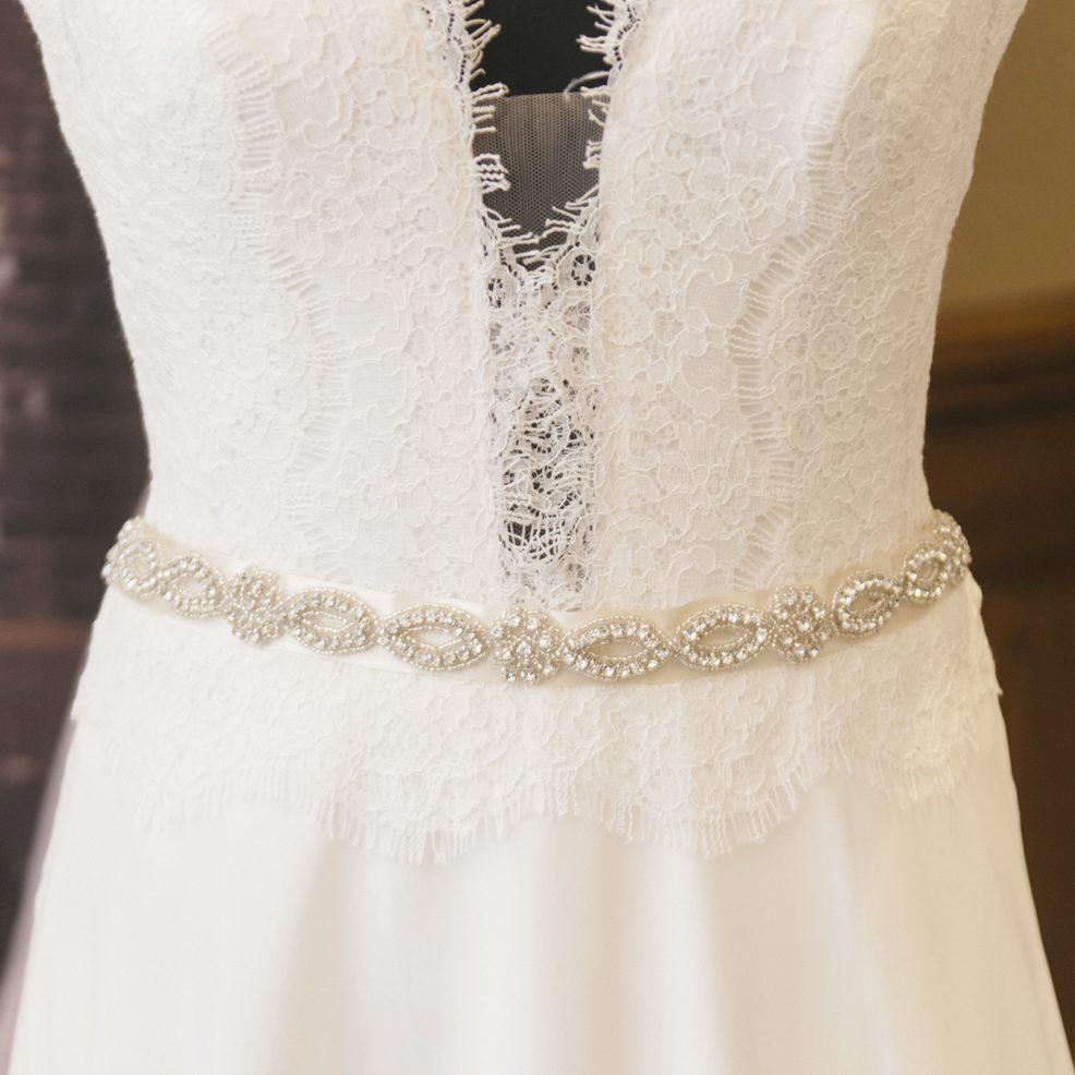 lucy wedding belt sash on wedding dress on mannequin