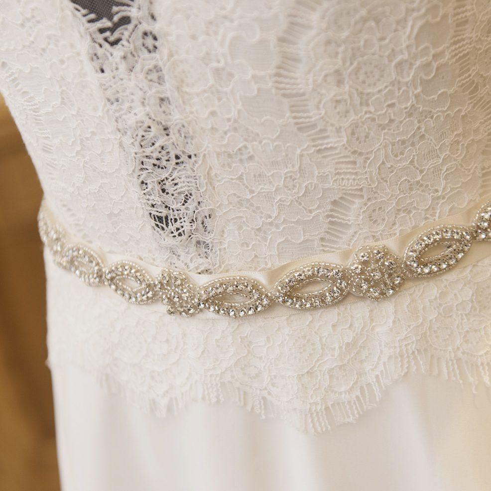 lucy wedding belt sash close up on dress on mannequin